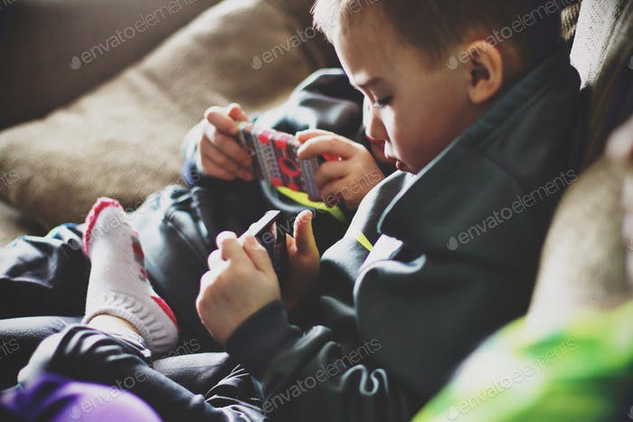 Little boy on iPhone