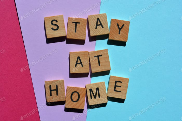 Stay At Home, Words in 3D wooden alphabet letters on colorful background