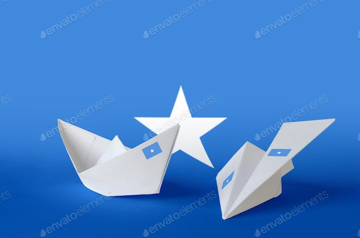 Somalia flag depicted on paper origami airplane and boat. Oriental handmade arts concept