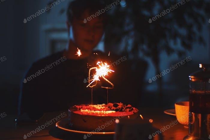 Birthday cake with fire sparklers. The big 20 twenty.