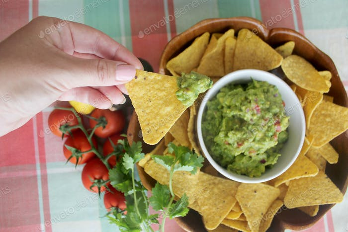 Fresh guacamole and corn chips for Cinco de Mayo