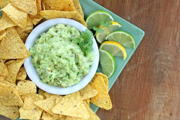 Guacamole and corn chips with lemon and lime - Superbowl chip and dip party food