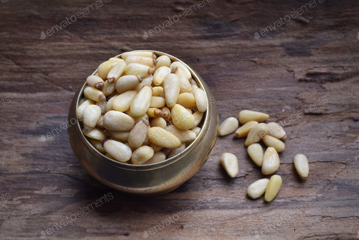 Pine nuts on a wooden table