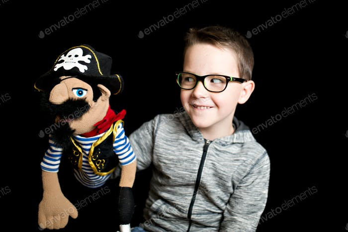 Boy and a pirate puppet