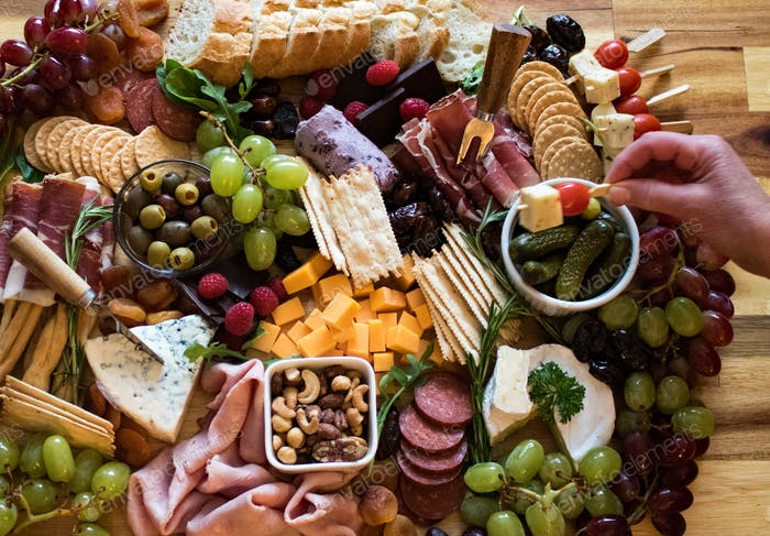 Cheese and fruit board from above.