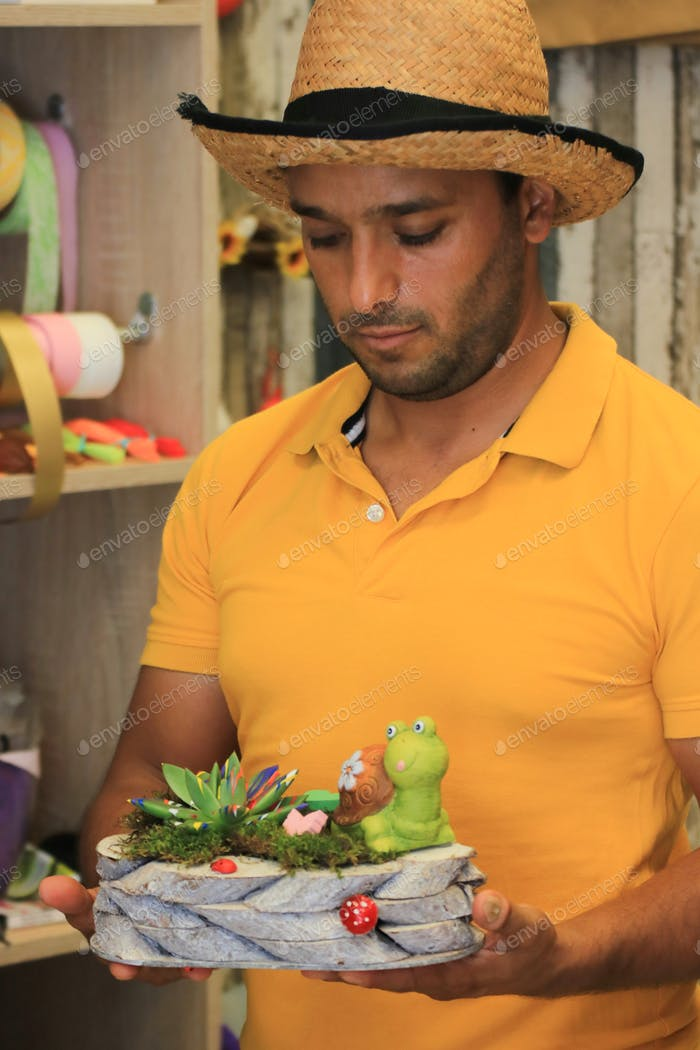 Man holding a flower decort