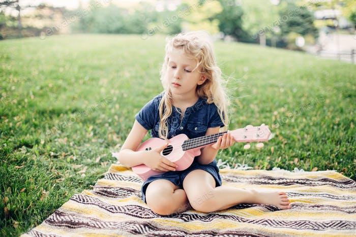 girl; music; hobby; sing; guitar; play; ukulele; artist; pensive; toy; fun; pink; authentic;