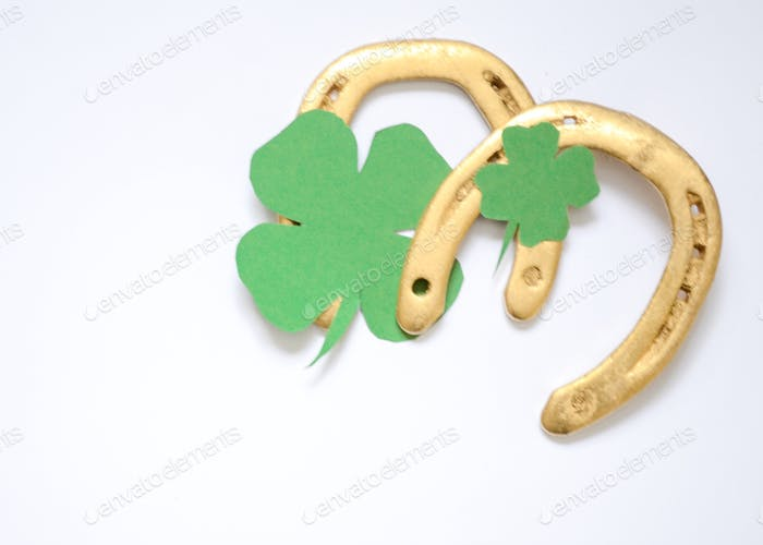 Golden horseshoes and green clover