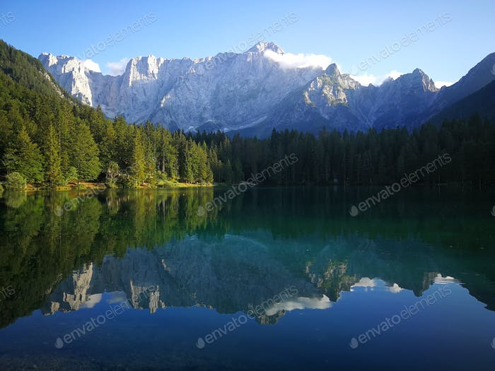 Reflection in a glacial lake in the Alps