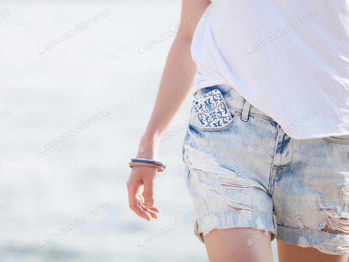 Girl in denim shorts and white T-shirt