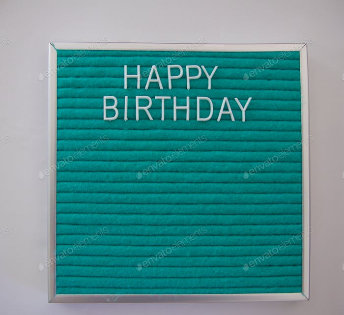Happy birthday on text letter board with room for copy