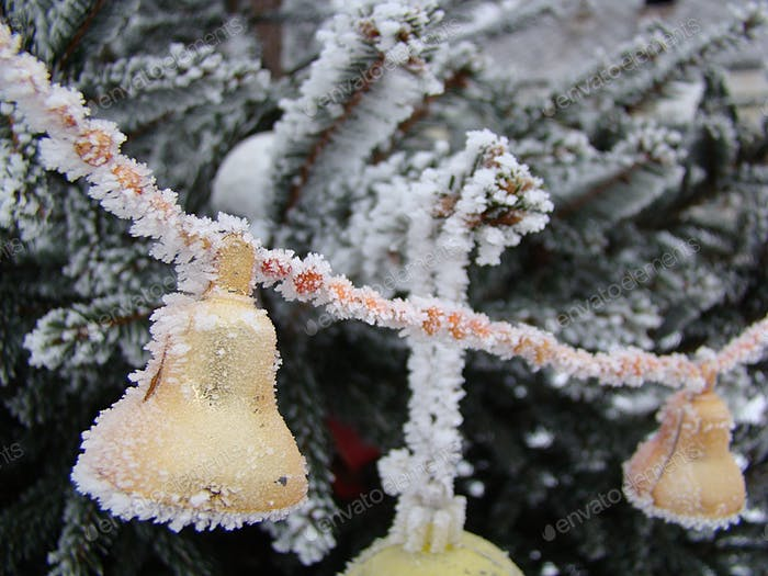 Hoar frost on christmas tree ornaments, background, winter holiday season.