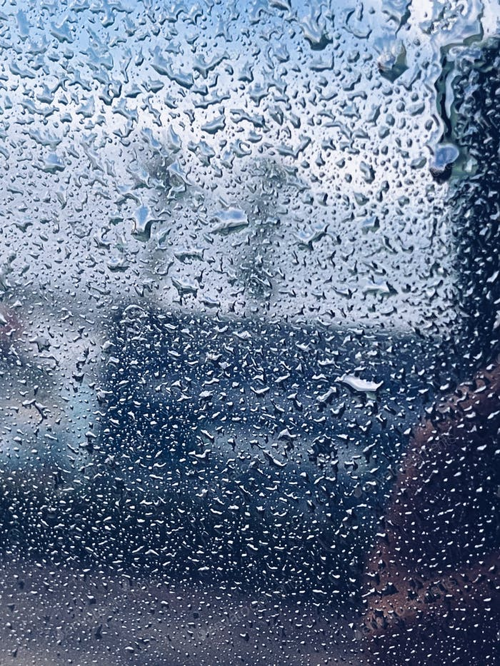 Water droplets on the glass on a natural background