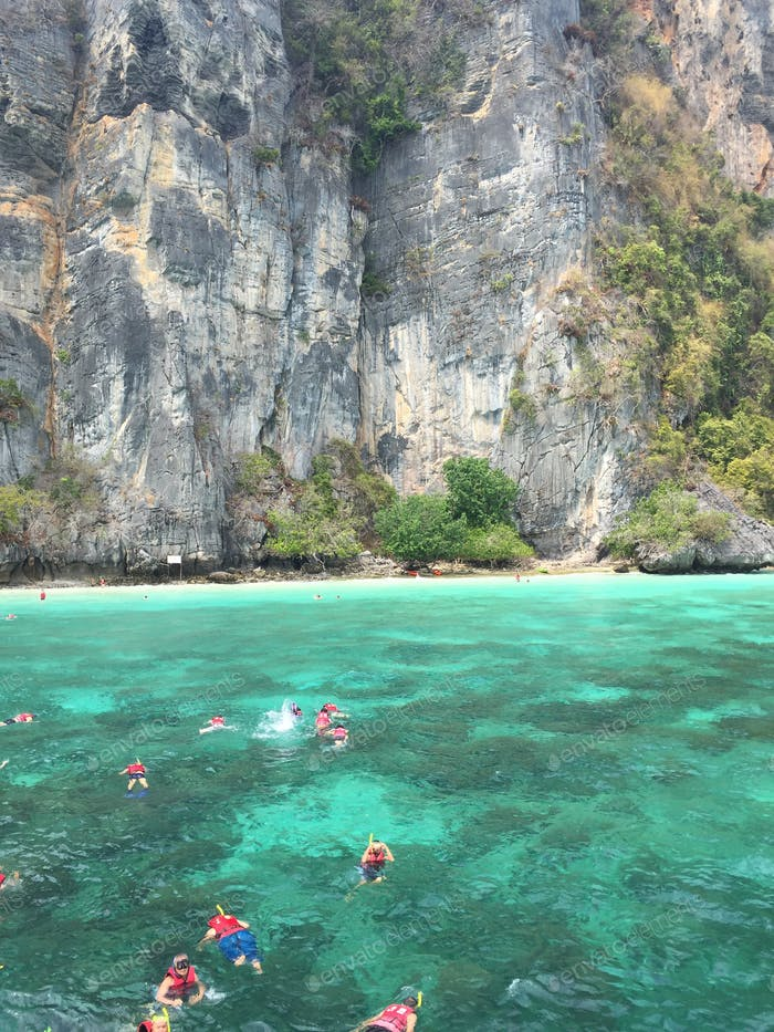 Enjoying an afternoon of snorkeling in Phuket with friends in the clear water and pristine