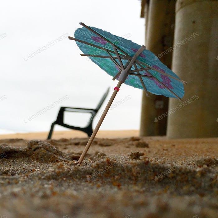Beach cleanup fun. Paper drink umbrella