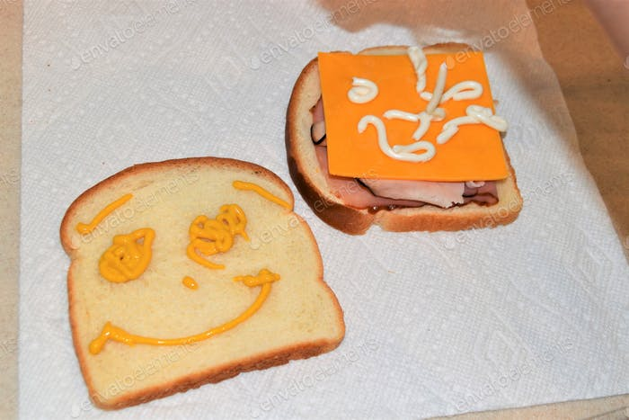 A creative sandwich made by a child with Mustard & Mayo!! :)