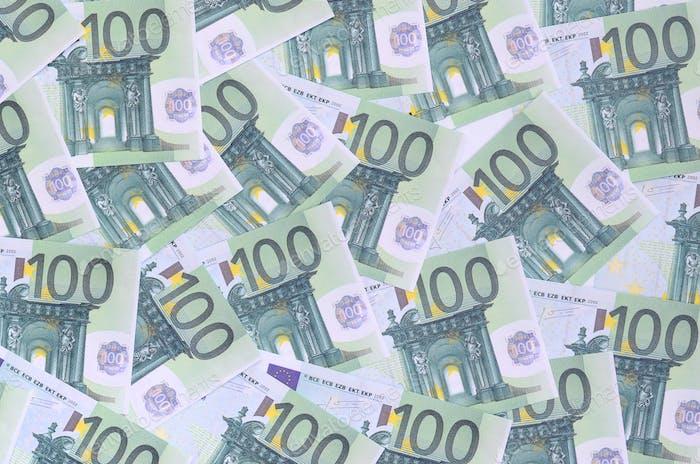 Patrón de fondo de un conjunto de denominaciones monetarias verdes de 100 euros