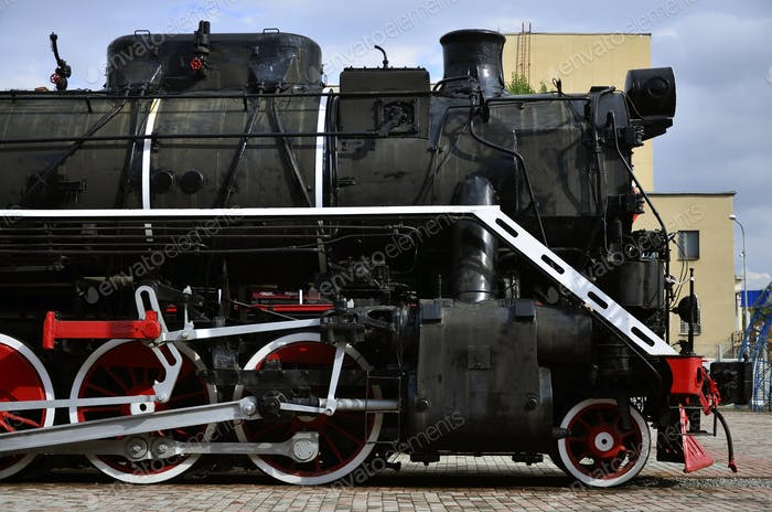 Antique black retro-train on track. A monument to the industrial achievements of the Soviet Union