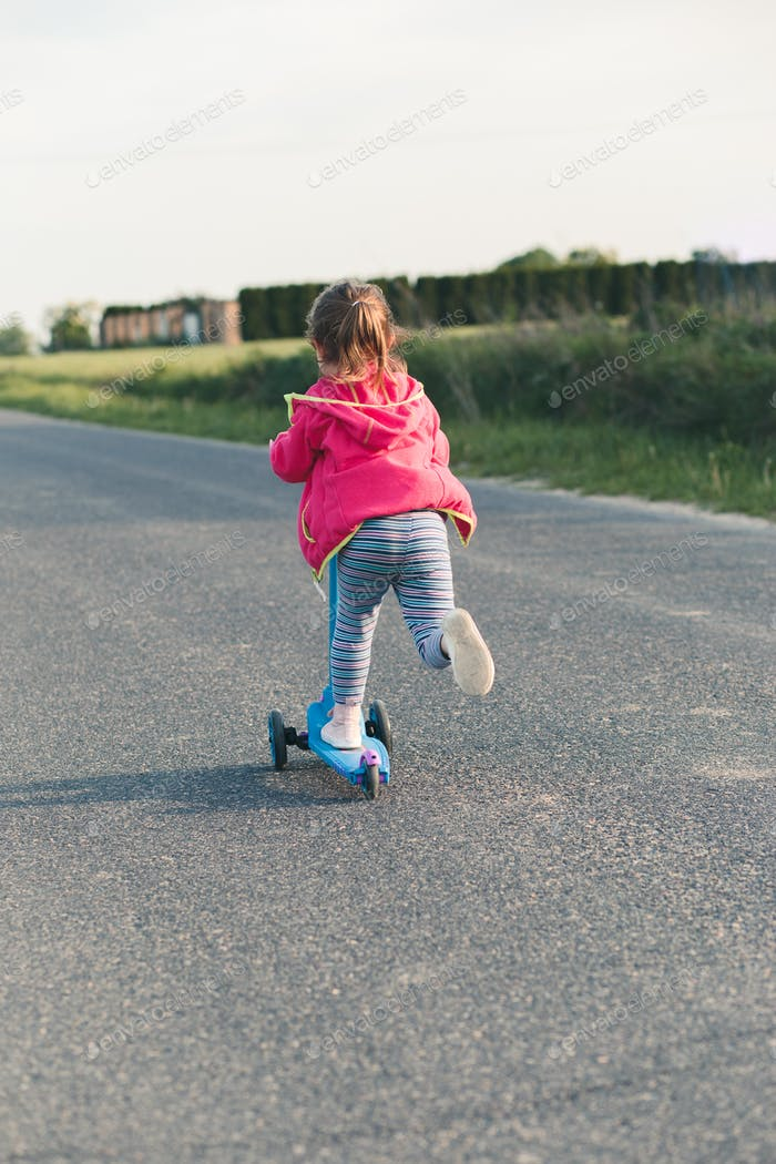 Young girl riding on roller skates. Real people, authentic situations