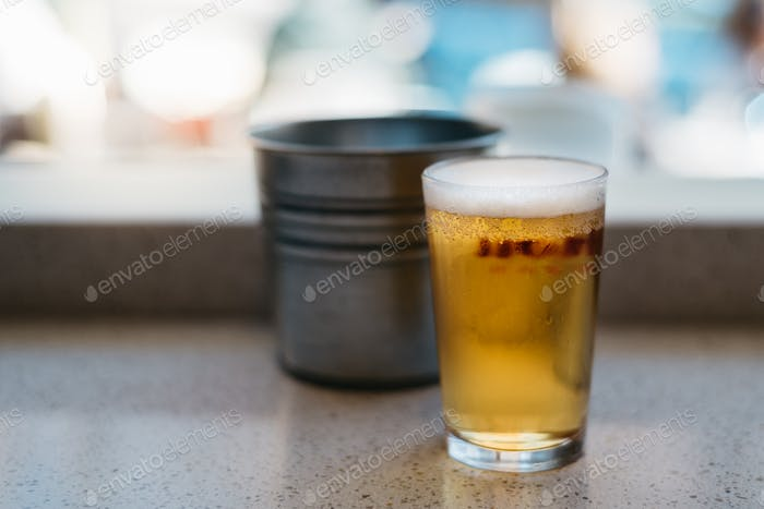 Close up of cold glass of beer. Focus on foreground