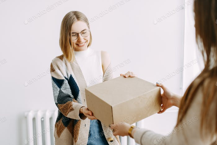 Girl, deliver, delivery, order, box, online shopping, courier, mail, isolation, happy, smile