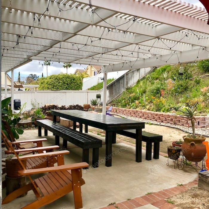 Backyard home decor space outdoor space picnic barn style table entertain family.