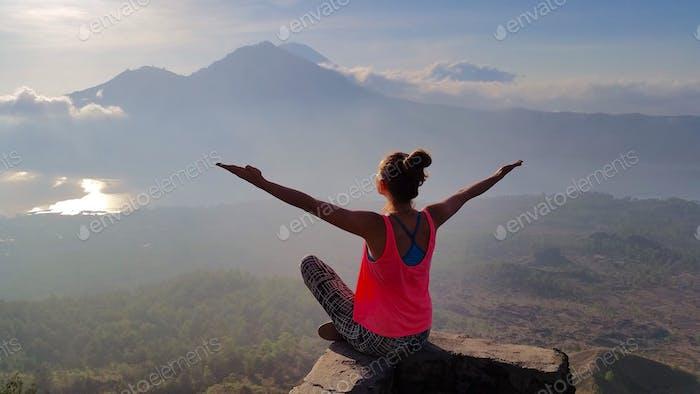 Meditation and yoga at the top of volcano Batur, Bali, Indonesia