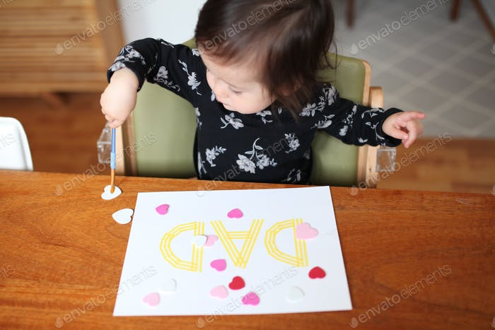 Toddler crafting a Father's Day card