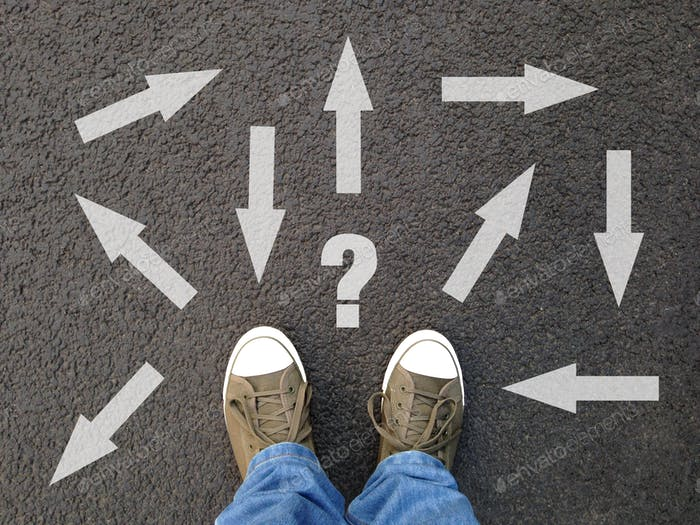 feet standing on asphalt with multitude of arrows in different directions and question mark