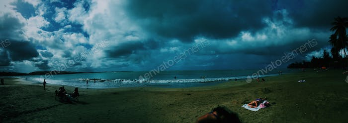 Panoramic view of coastal beachside as stormy weather hits