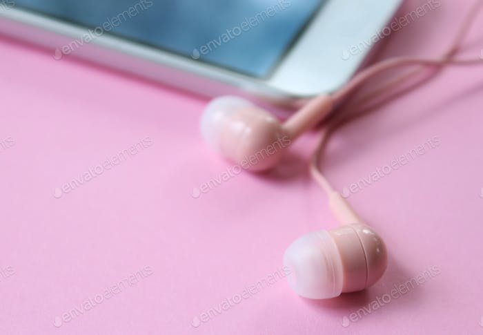 Cell phone with pink ear buds