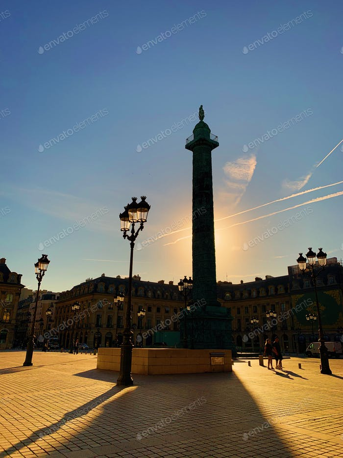 Sunlight and backlight in the famous Place Vendôme in Paris, summertime, incidental people