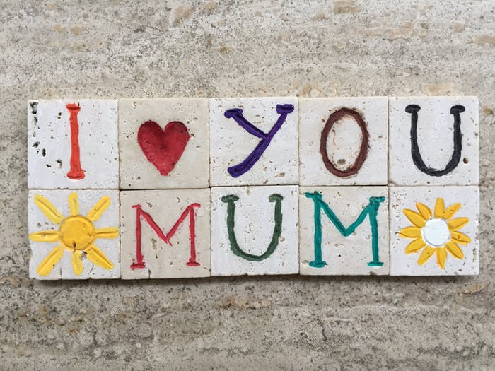 i love you mum, creative carved travertine pieces on a marble background