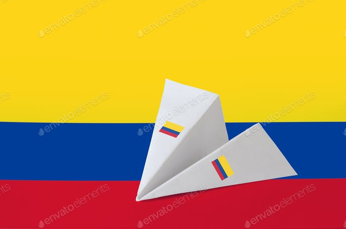 Colombia flag depicted on paper origami airplane. Oriental handmade arts concept