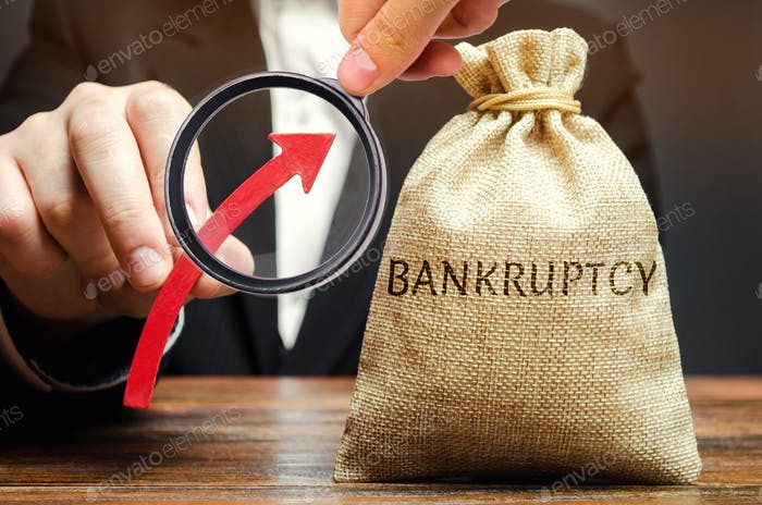 A bag with the word Bankruptcy and an up arrow in the hands of a businessman