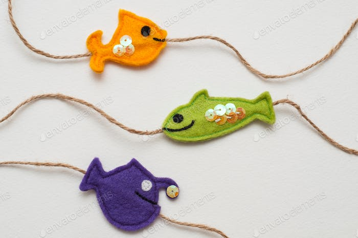 Funny felt toy.  Three colorful fishes on a cord. Handmade toy.