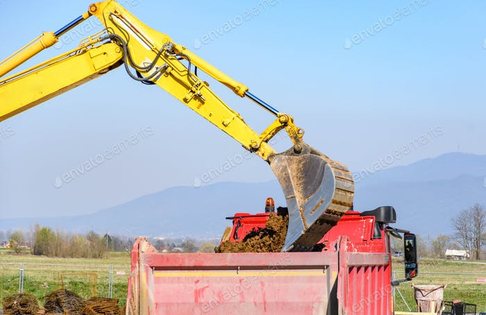 Construction machinery at construction site.