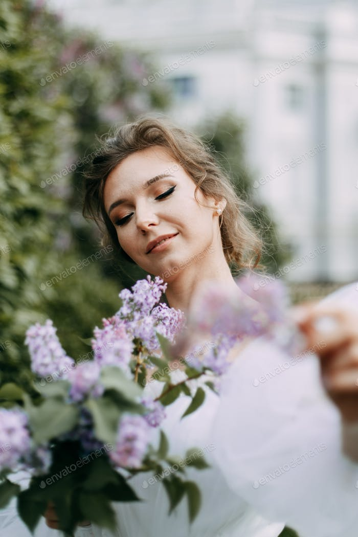 Bride; woman; young; wedding Dress; spring; bloom; park; inspiration; nature; beauty; apple trees; a