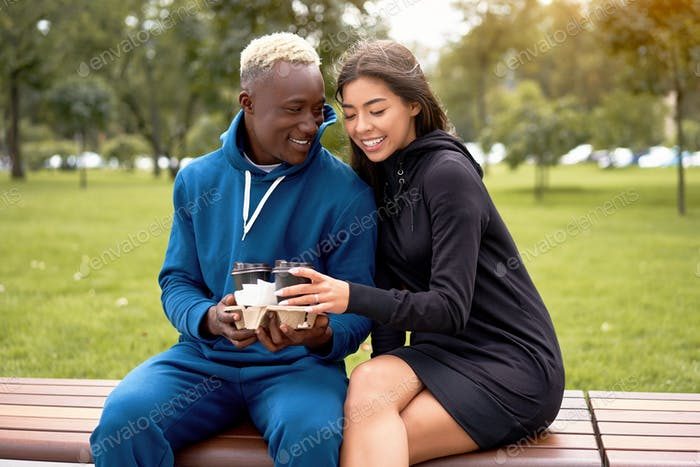 African american man proposes coffee asian woman Multiethnic friendship