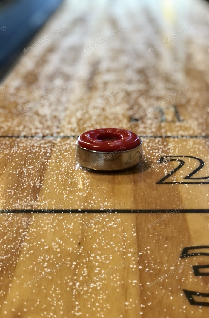 Red table Shuffleboard disk