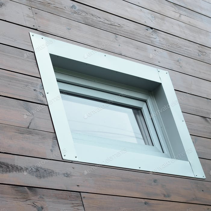 Plastic PVC window in modern passive wooden house facade wall