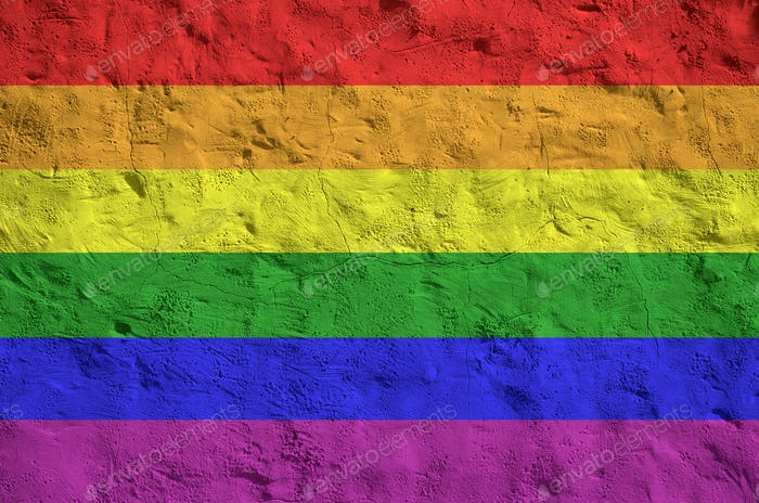 LGBT community flag depicted in bright paint colors on old relief plastering wall close up