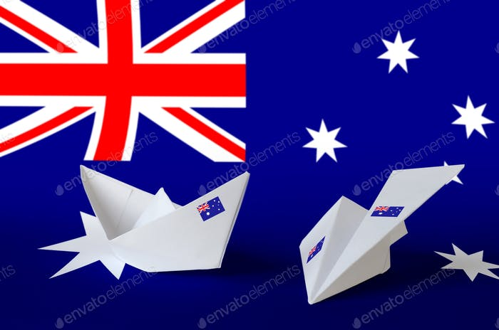 Australia flag depicted on paper origami airplane and boat. Oriental handmade arts concept