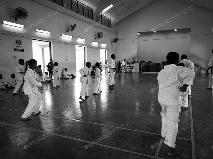 martial art karate do practice in the community hall in malaysia. black and white monochrome