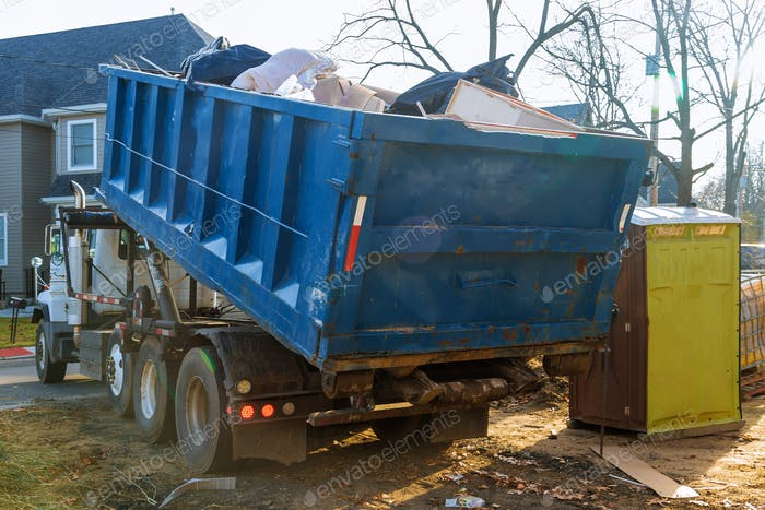 Removal of debris construction waste building demolition with rock and concrete rubble on portable