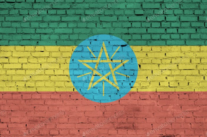Ethiopia flag is painted onto an old brick wall