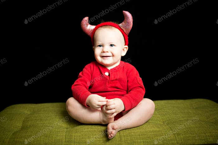 baby in a devil costume