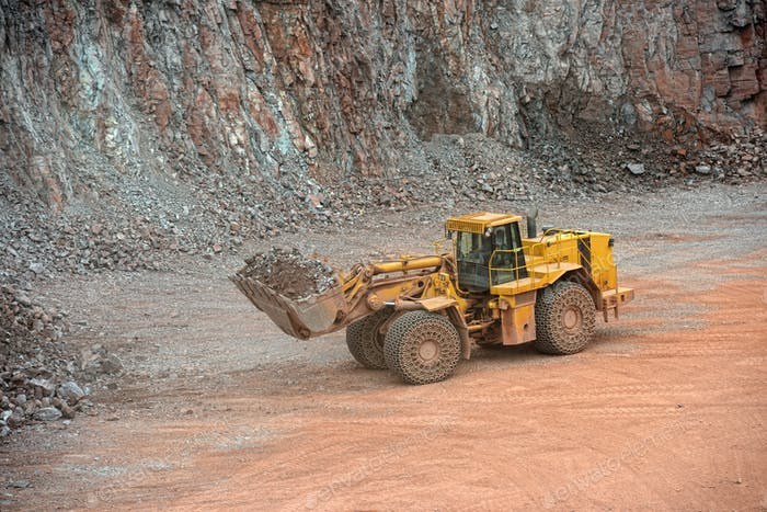 Earth mover loading rocks in a quarry. mining industry.