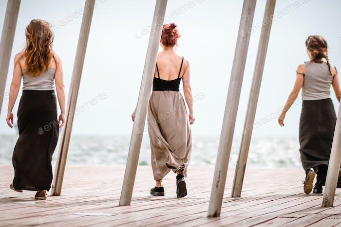 Three Women Dancers On The Dock