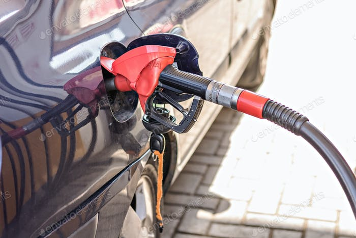 Refueling with gasoline using a gasoline pump car at a gas station.
